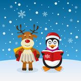 Cute Christmas Penguin and Reindeer Royalty Free Stock Photo