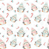 Cute Christmas penguins seamless pattern Stock Image