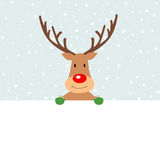 Cute Christmas reindeer holding a blank banner Royalty Free Stock Image