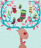 Cute Christmas Reindeer with Stocking Stock Image