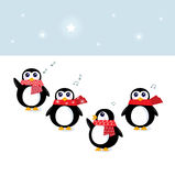 Cute christmas singing Penguins Stock Photos