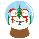 Cute Christmas snowmen inside a snowglobe Royalty Free Stock Photo