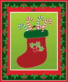 Cute christmas stocking with candy canes Royalty Free Stock Image