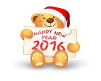Cute Christmas teddy bear with the 2016 banner. In the paws Royalty Free Stock Image