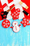 Cute Christmas tree embellishment. Felt snowman, Christmas tree, star and ball embellishment, materials and tools for sewing. Christmas kids DIY background Stock Photography