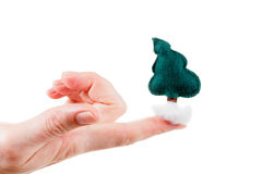Cute Christmas tree in her hand. Concept greetings Stock Photo