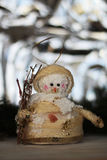 Cute christmas tree snowman decoration. And christmas tree as background Royalty Free Stock Photo