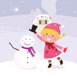 Cute christmas winter girl in making snowman Stock Photography