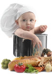 Cute Chubby Baby Chef in a Cooking Pot. With Vegetables. Image is Soft Royalty Free Stock Images