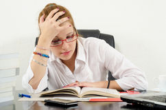 Cute chubby girl preparing for exams Stock Image