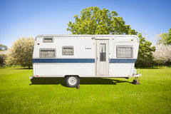 Cute Classic Old Camper Trailer In Grass Field Royalty Free Stock Image