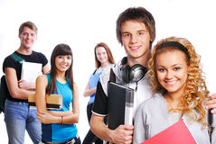 Cute clever couple. On foreground. On background classmates stock image