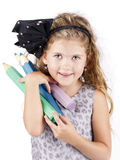 Cute and clever little girl with big crayons Royalty Free Stock Photo