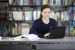Cute college girl at the library Stock Photography