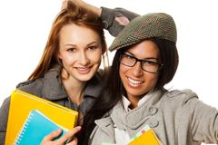 Cute college students smiling at camera Stock Image