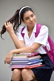 Cute Colombian Female Student With Long Hair Wearing School Uniform With Books
