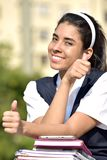 Cute Colombian Female Student With Thumbs Up With Books stock image