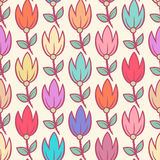 Cute color tulips. Cute seamless pattern with colorful tulips on a beige background Royalty Free Stock Photo