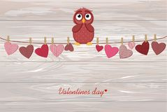 Cute colored owlet sitting on a string. A red hearts with a pict. Ure hanging on a rope. Valentine`s Day. Vector illustration. Greeting card with empty space for royalty free illustration