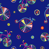 Cute colorful beautiful bicycles seamless pattern with flowers and birds and decorative wheels Stock Images