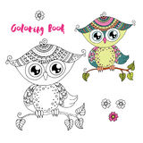 Cute colorful cartoon owl sitting on tree branch on white background Stock Image
