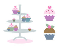 Cute and colorful cupcakes. Set of three different cupcake (fairy cake) illustrations in pastel colors Royalty Free Stock Image