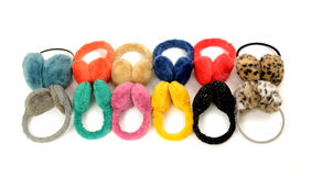 Cute colorful earmuffs arranged in a line. Stock Photography