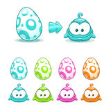 Cute colorful eggs with little funny monsters. Stock Photography