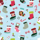 Colorful seamless pattern with winter boots. Cute and colorful seamless pattern with winter boots and gift stockings stock illustration