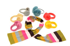 Cute colorful striped scarf and matching earmuffs. Stock Image