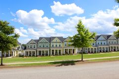 Cute, colorful townhouse neighborhood. Quaint southern style neighborhood with colorful townhouses under a blue sky with clouds. Verdae homes Stock Photos