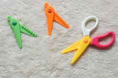 Colorful zigzag scissors with changeable blade on white fur background royalty free stock photos
