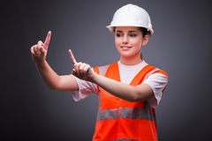 The cute construction worker pressing virtual buttons Royalty Free Stock Image