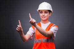 The cute construction worker pressing virtual buttons Royalty Free Stock Images