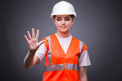 The cute construction worker pressing virtual buttons Stock Image