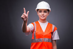 The cute construction worker pressing virtual buttons Stock Photos