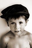 Cute content smiling boy in hat Royalty Free Stock Photos