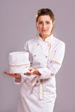 Cute cook girl Stock Images