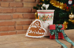 Cute cookie and small gift with cinamon cup of tea for Christmas Royalty Free Stock Photos