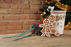 Cute cookies and small gift with cinamon cup of tea for Christma Royalty Free Stock Photo