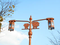 Cute Copper Color Traditional Style Street Lamp against the Autumn Blue Sky Royalty Free Stock Photos