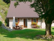 Cottage in the mountain. Cute cottage in the mountain Royalty Free Stock Image