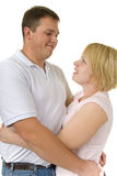 Cute couple in 30s share a moment. Cute loving couple share a special moment together with a hug stock photos