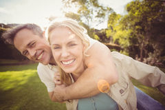 Cute couple with arms around each other Royalty Free Stock Image