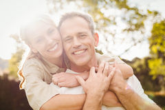 Cute couple with arms around each other Stock Photos