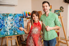Cute couple at an art school Stock Images
