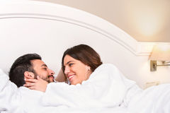 Cute Couple in bathrobe showing affection. Royalty Free Stock Images