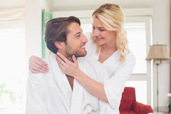 Cute couple in bathrobes spending time together Stock Images