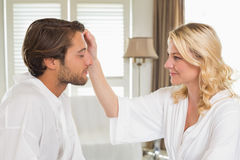 Cute couple in bathrobes spending time together Royalty Free Stock Photos