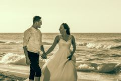Lovely couple in the beach royalty free stock photography